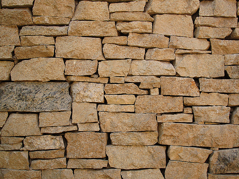 What's the Difference Between Brick Walls and Dry Stone Walls?